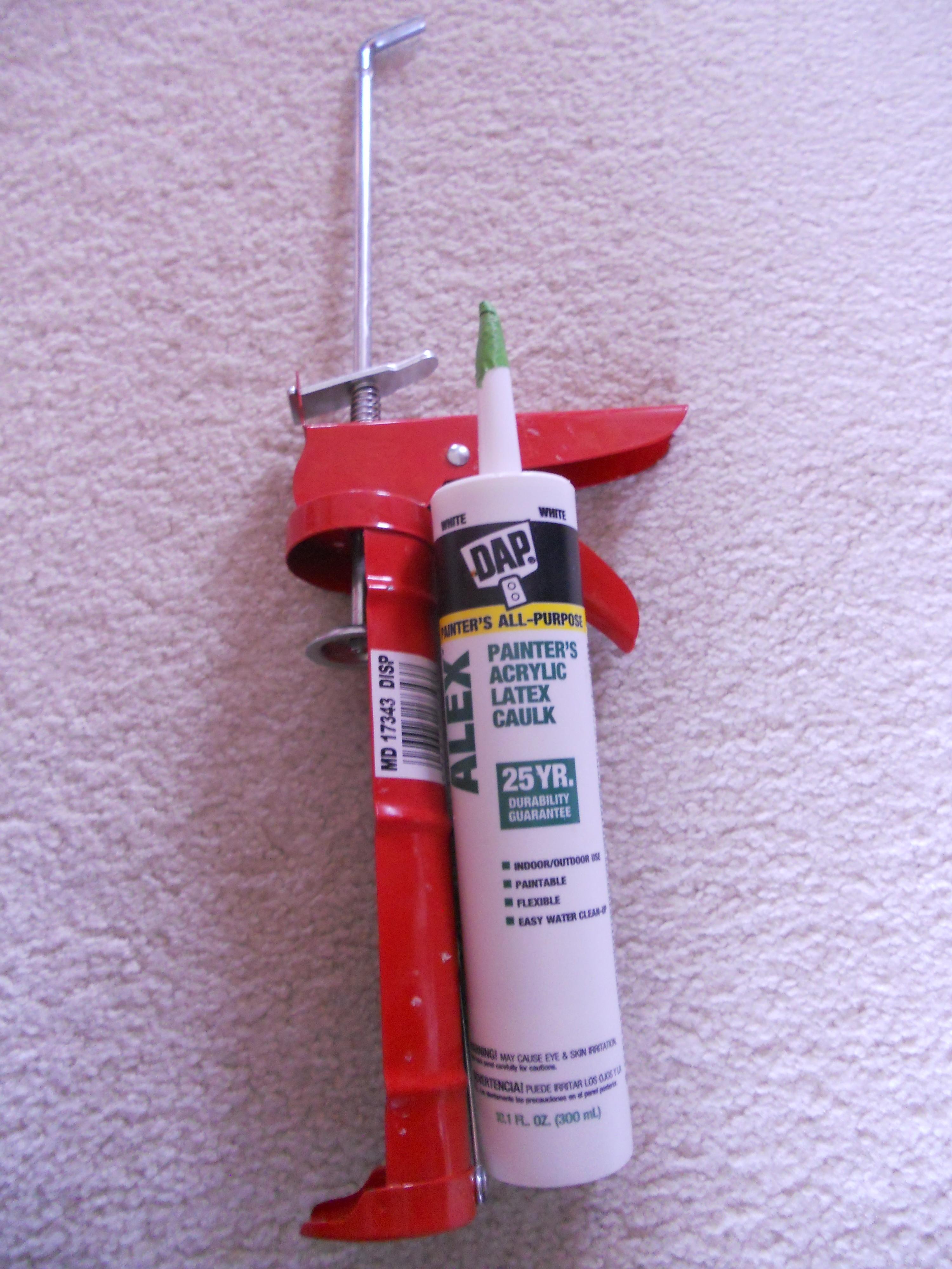 Silicon gun. the green tube is a caulk not a silicon.