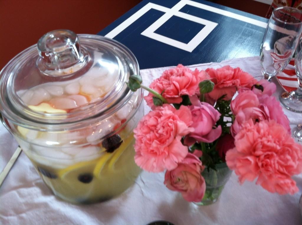 Margarita with sliced lemons, apples and some blackberries.