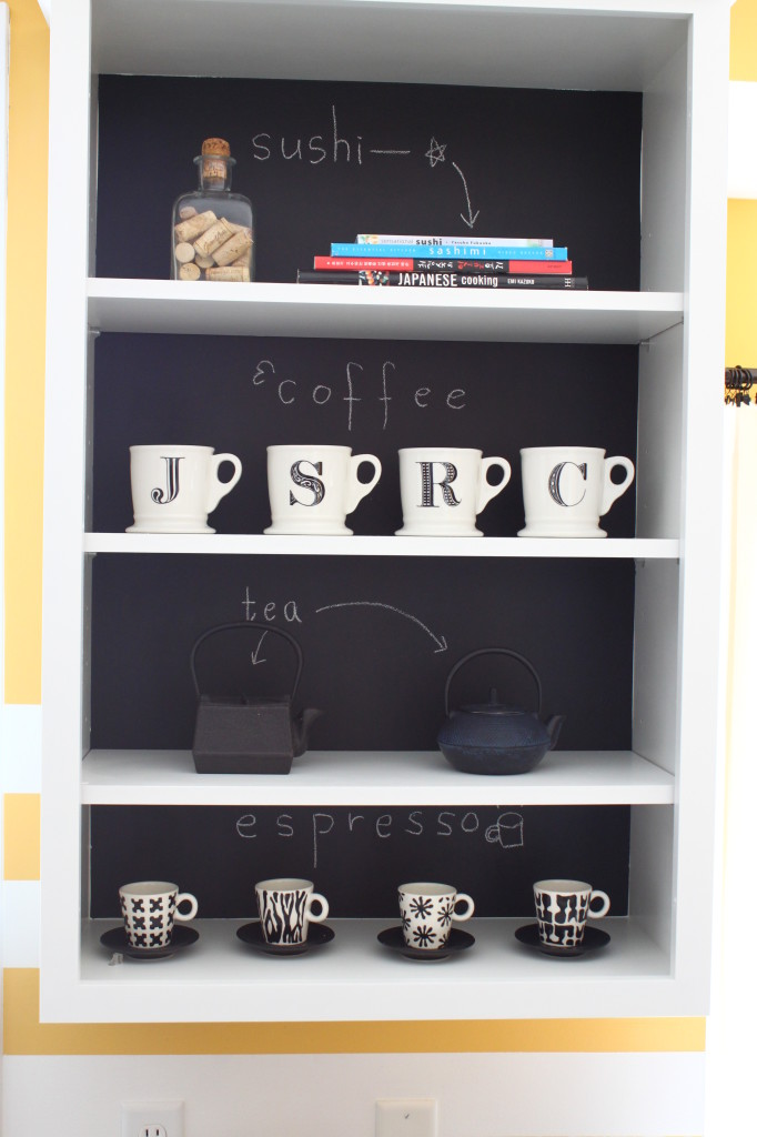 THe blackboard behind them looks cool with the white/black mugs.