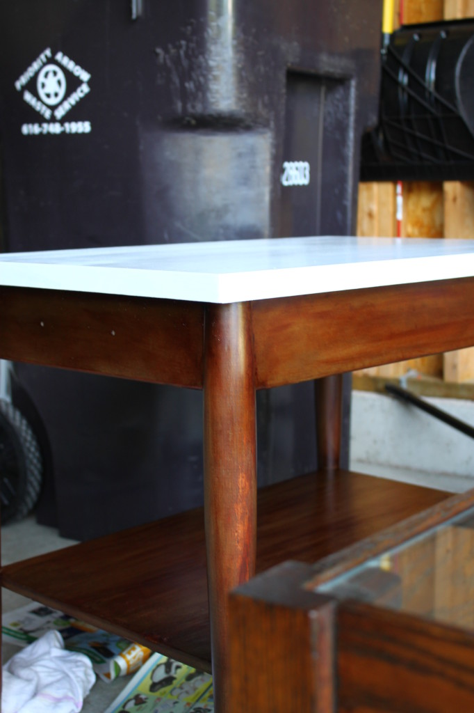 You can see a coffee table beside the side table that I got from CL as well. It is oak table with the glass top.