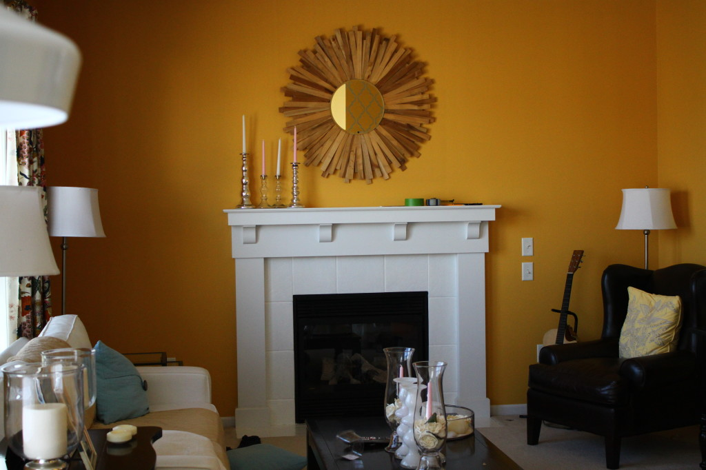Before. My white fireplace looked good with yellow wall, but not the mirror.