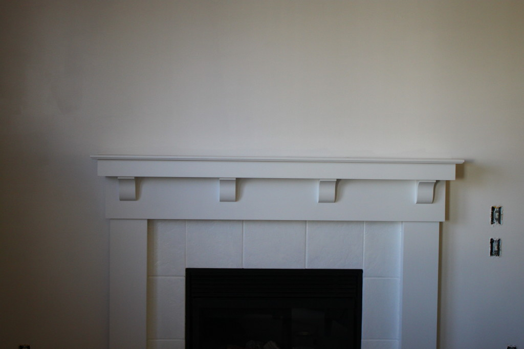 I also painted the mantle and tiles not to have two different toned white which is very ugly.