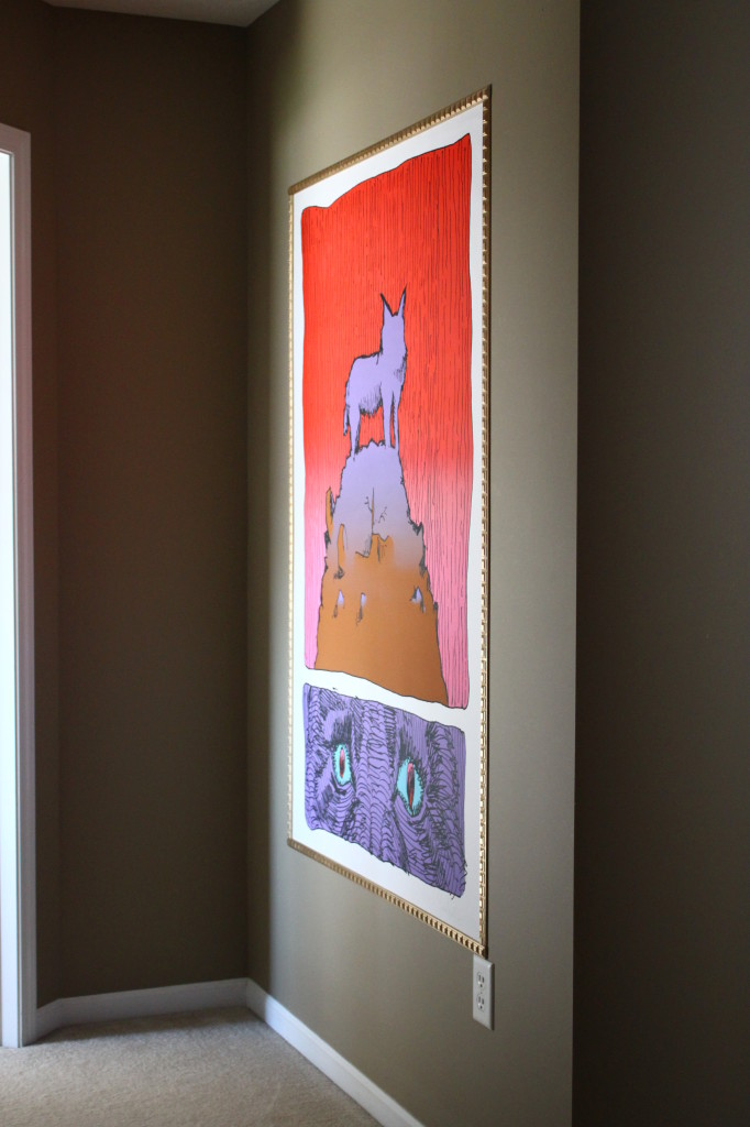 After marking the corners and using the poster tapes, I hung the print easily. A finished look.